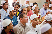 "25 SEPTEMBER 2009 -- PATTANI, THAILAND: Men at prayers in the Central Mosque in Pattani, Thailand. Thailand's three southern most provinces; Yala, Pattani and Narathiwat are often called ""restive"" and a decades long Muslim insurgency has gained traction recently. Nearly 4,000 people have been killed since 2004. The three southern provinces are under emergency control and there are more than 60,000 Thai military, police and paramilitary militia forces trying to keep the peace battling insurgents who favor car bombs and assassination.  PHOTO BY JACK KURTZ"