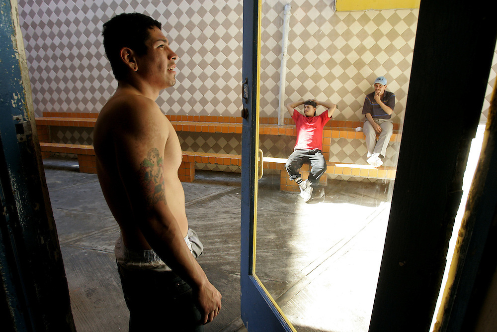 A recovering Heroin addict, who chose to remain anonymous, stands in a doorway after exercising at the Los Tesoros Escondidos Drug Rehabilitation Center in Tijuana, Mexico.