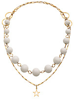 gold necklace with white beads on one strand and a star charm on the other photographed on a white background