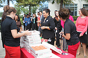"""Krispy Kreme Doughnuts makes a special stop at Hattie Mae White Educational Center as part of the company's """"Glaze the Nation Tour,"""" handing out free doughnuts and prizes to employees."""