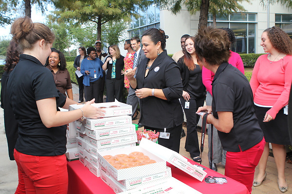 "Krispy Kreme Doughnuts makes a special stop at Hattie Mae White Educational Center as part of the company's ""Glaze the Nation Tour,"" handing out free doughnuts and prizes to employees."