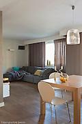 Interior of small modern apartment in Krakow Poland . Photography by Piotr Gesicki