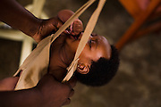 A child gets weighted to track her growth at the Osu Maternity Home in Accra, Ghana on Tuesday June 16, 2009.