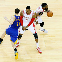 25 May 2015: Houston Rockets guard James Harden (13) drives past Golden State Warriors guard Klay Thompson (11) on a screen set by Houston Rockets center Dwight Howard (12) during the Houston Rockets 128-115 victory over the Golden State Warriors, in game 4 of the Western Conference finals, at the Toyota Center, Houston, Texas, USA.