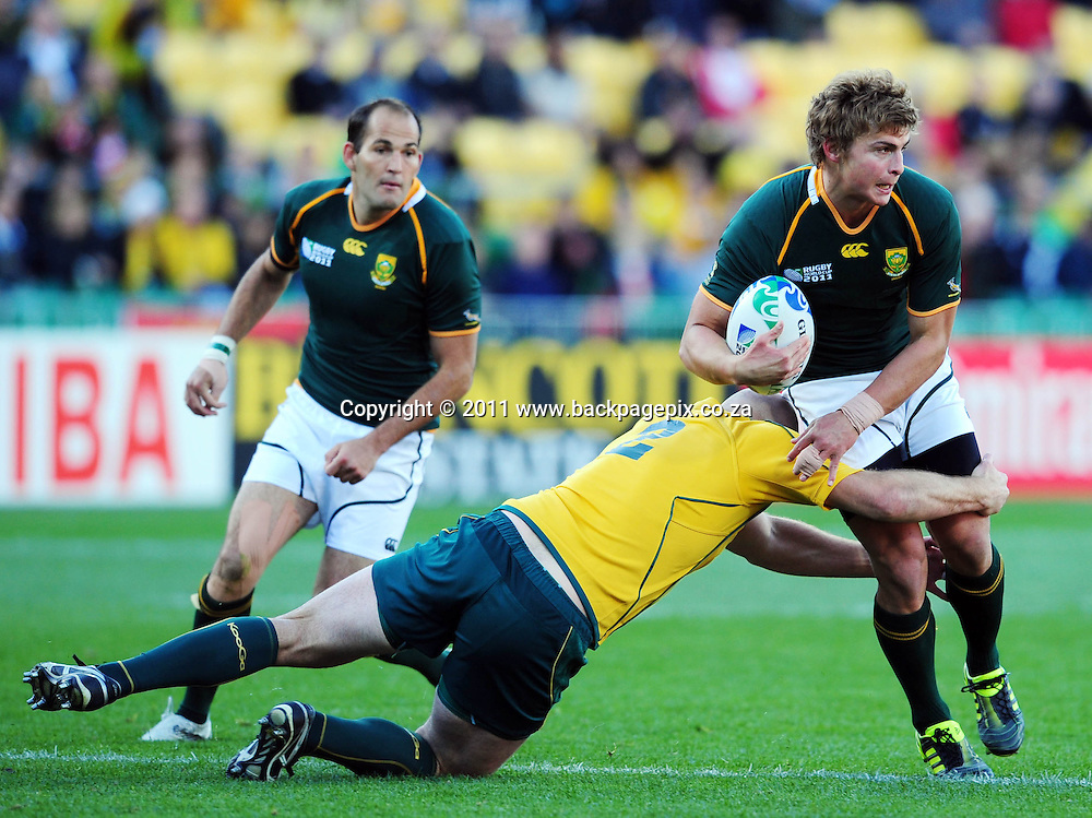 Pat Lambie of South Africa tackled by Stephen Moore of Australia Rugby - 2011 Rugby World Cup - 3rd Quarter Final - South Africa v Australia - Wellington Regional Stadium<br /> &copy; Barry Aldworth/Backpagepix