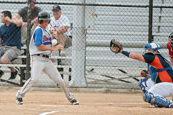 27 June 2014:   Tyler Johnson during a Mens Professional Fastpitch Softball game between the Central Illinois Knights from Villa Grove and the Bloomington Stix from Bloomington, played at O'Neil Park in Bloomington, Illinois