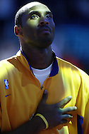 Kobe Bryant listens to the National Anthem before the Lakers' 94-79 victory over the Toronto Raptors at Staples Center Wednesday November 12, 2003.