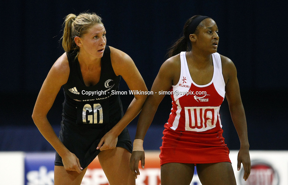 PICTURE BY VAUGHN RIDLEY/SWPIX.COM...Netball - International Netball Series - England v New Zealand - Capital FM Arena, Nottingham, England - 17/01/11...New Zealand's Casey Williams and England's Sasha Corbin.