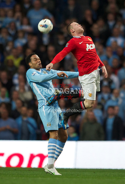 MANCHESTER, ENGLAND - Monday, April 30, 2012: Manchester City's Joleon Lescott in action against Manchester United's Wayne Rooney during the Premiership match at the City of Manchester Stadium. (Pic by Chris Brunskill/Propaganda)