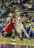 February 16 2011: Iowa Hawkeyes guard Jaime Printy (24) tries to get around Wisconsin Badgers guard Jade Davis (00) during the first half of an NCAA women's college basketball game at Carver-Hawkeye Arena in Iowa City, Iowa on February 16, 2011. Iowa defeated Wisconsin 59-44.
