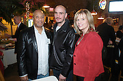 """AC McCullough, left,  and Kelly Stevens, right, with WHOT Hot 101 along with Kelly """"The Ghost"""" Pavlik, center,Valley Magazine launch party at the Youngstown Crab Co. on Feb. 21, 2008."""