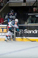 KELOWNA, CANADA - JANUARY 16: Leon Draisaitl #29 of Kelowna Rockets checks Jared Hauf #33 of Seattle Thunderbirds into the boards on January 16, 2015 at Prospera Place in Kelowna, British Columbia, Canada.  (Photo by Marissa Baecker/Shoot the Breeze)  *** Local Caption *** Leon Draisaitl; Jared Hauf;