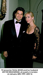 TV presenter TANIA BRYER and her husband MR TIM MOUFARRIGE, at a party in London on January 30th 1997.LWD 16