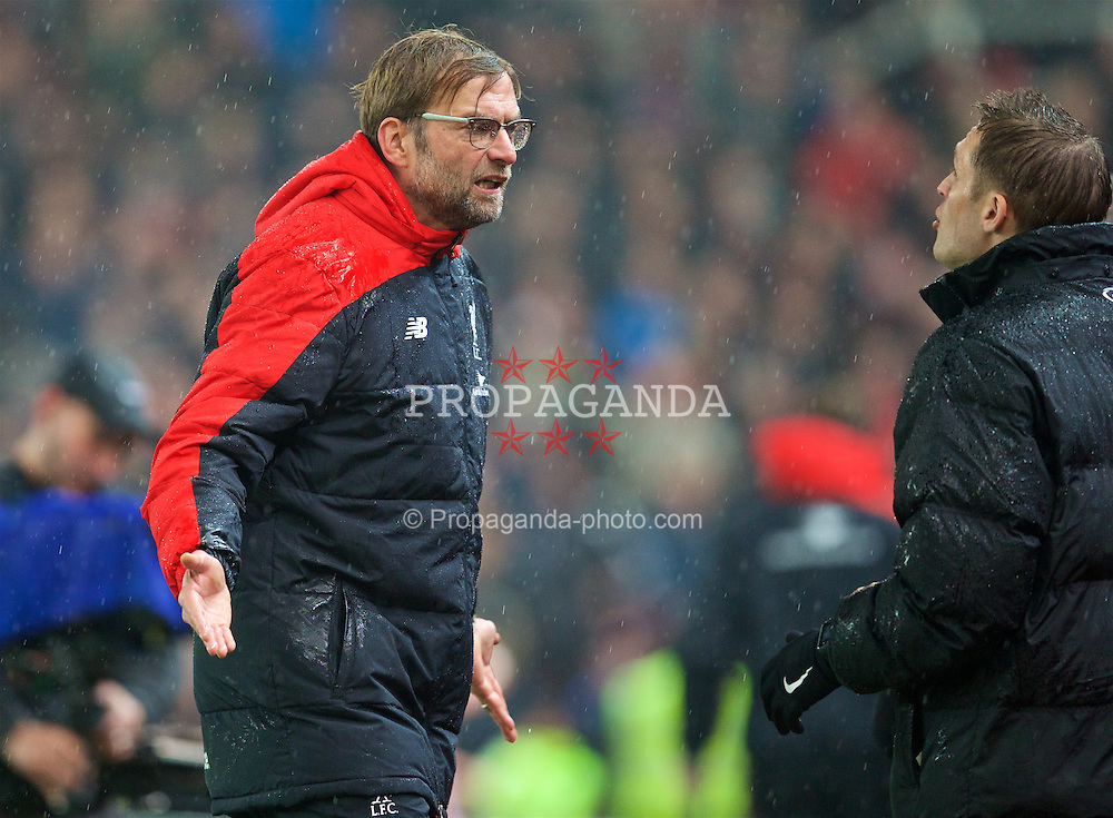 STOKE-ON-TRENT, ENGLAND - Tuesday, January 5, 2016: Liverpool's manager Jürgen Klopp argues with the fourth official during the Football League Cup Semi-Final 1st Leg match against Stoke City at the Britannia Stadium. (Pic by David Rawcliffe/Propaganda)