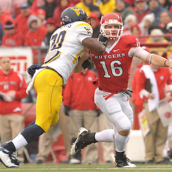 Dec 5, 2009; Piscataway, NJ, USA; Rutgers long snapper Andrew Depaola (16) blocks on a punt during first half NCAA Big East college football action between Rutgers and West Virginia at Rutgers Stadium.