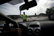 A road block 25km into the Greek/Turkish/Bulgarian border.  Human trafficking is a common method for bringing in illegal immigrants.  With these road blocks in place 24 hours a day, illegal immigrants are finding crossing into Greece is getting harder and harder.  With statistics in 2012, from 130,000 illegal immigrants made it into Greece.  After the new methods put in place this number has declined to 35,000 in 2013.  Image © Angelos Giotopoulos/Falcon Photo Agency