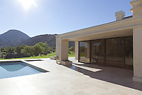 House exterior with pool and view of mountains
