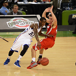 Mar 31, 2012; New Orleans, LA, USA; Kansas Jayhawks guard Tyshawn Taylor (10) dribbles around Ohio State Buckeyes guard Aaron Craft (4) during the first half in the semifinals of the 2012 NCAA men's basketball Final Four at the Mercedes-Benz Superdome. Mandatory Credit: Derick E. Hingle-US PRESSWIRE