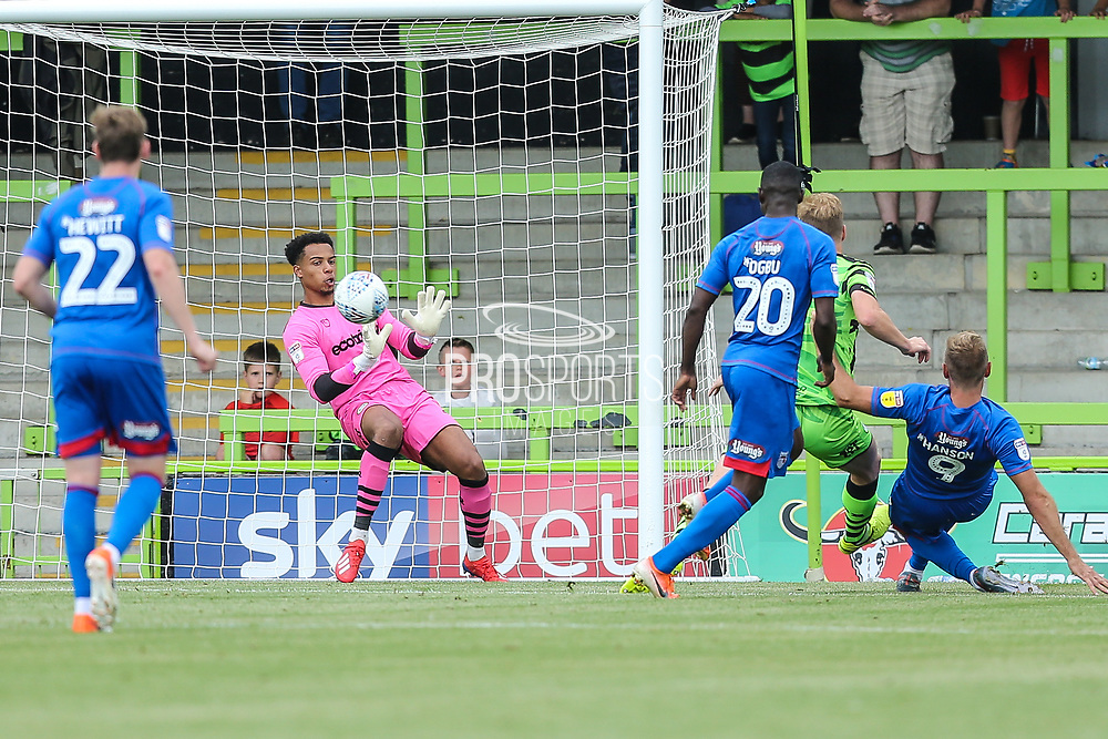 Grimsby Town's James Hanson(9) shoots at goal saved by Forest Green Rovers goalkeeper Joe Wollacott(13) during the EFL Sky Bet League 2 match between Forest Green Rovers and Grimsby Town FC at the New Lawn, Forest Green, United Kingdom on 17 August 2019.