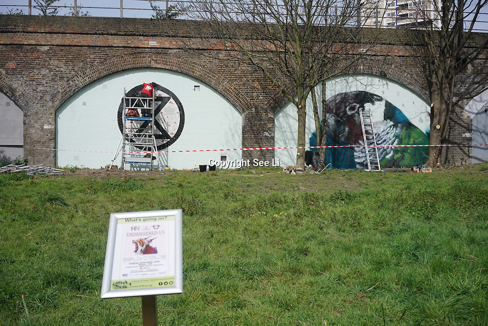 London,England,UK : 10th April 2016 : Karen Wydler and Carrie Reichardt street artists paint a live extinction for the 'Endangered 13' at Ackroyd Drive Sponsor by Tower Hamlets council in London. Photo by See Li