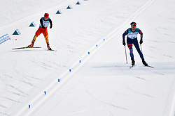 DAVIET Benjamin FRA LW2, MA Mingtao CHN LW5/7 competing in the ParaSkiDeFond, Para Nordic Skiing, 20km at  the PyeongChang2018 Winter Paralympic Games, South Korea.