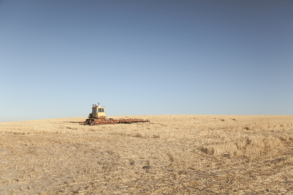 Wheat field and old combine, Dufur, Oregon.