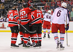Feb 27, 2014; Newark, NJ, USA; The New Jersey Devils celebrate a goal by New Jersey Devils center Travis Zajac (19) during the first period of their game against the Columbus Blue Jackets at Prudential Center.