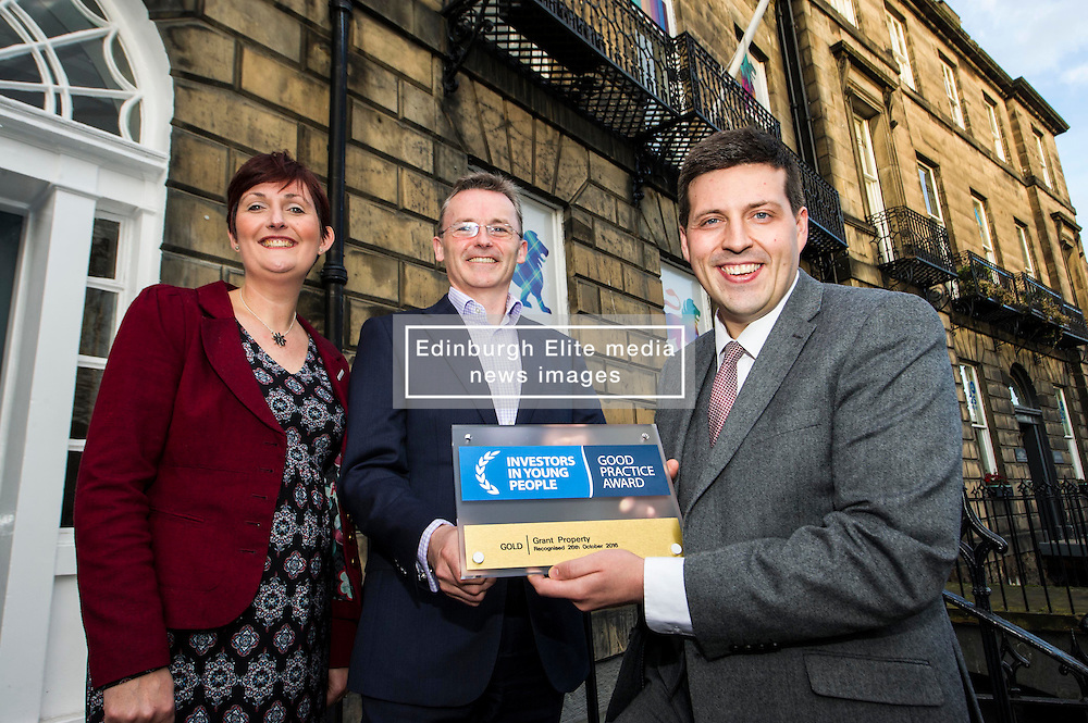 Pictured: Laura Peacock, Investors in Young People, hands over the gold award to John Moran, managing director Grant Properties and Jamie Helpburn<br /> <br /> Employability and training minister Jamie Hepburn MSP, visited Grant Property in Edinburgh today to announce the latest labour market statistics and to award the company the 350th Investors in Young People award. <br /> <br /> Ger Harley | EEm 14 December 2016