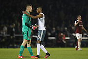 Marcus Rashford Forward of Manchester United consoles Northampton Town goalkeeper Adam Smith (1) during the EFL Cup Third Round match between Northampton Town and Manchester United at Sixfields Stadium, Northampton, England on 21 September 2016. Photo by Phil Duncan.