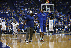 Kentucky Alum Willie Cauley-Stein, right talks with  Karl Towns before the game. The Kentucky Alumni Men's Basketball team hosted the University of North Carolina Alumni in a charity game, Sunday, Sept. 13, 2015 at Rupp Arena in Lexington. <br /> <br /> Photo by Jonathan Palmer