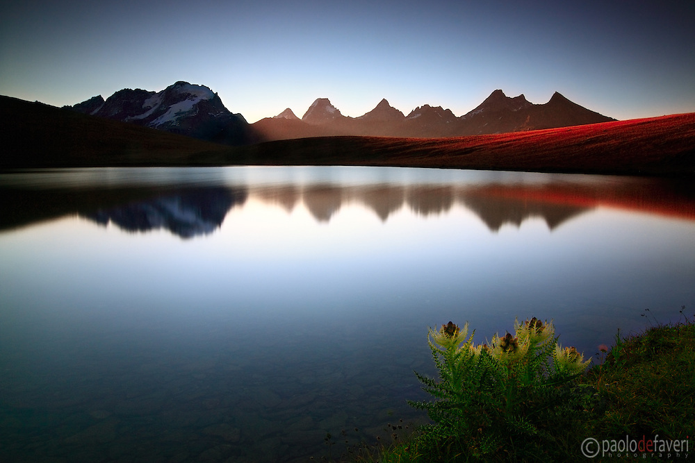 """The sun rose from behind the ridges just a few moments after the shutter closed.This is lake Rosset with the Gran Paradiso range in the background. Lake Rosset lies in the """"lakes region"""", the heart of the Gran Paradiso National Park, the largest and oldest protected area of Italy."""