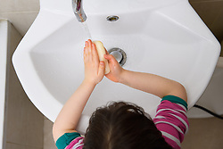 A four year old child washes her hands in a bathroom in London. Hand washing is recommended as one of the key measures to slow down transmission of Coronavirus. Picture date: Monday March 16, 2020. Photo credit should read: Matt Crossick/Empics