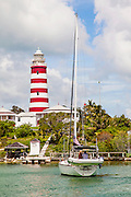 Hope Town lighthouse and harbor in the tiny village of Hope Town, Elbow Cay Abacos, Bahamas.