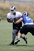 Los Angeles Rams rookie center Brian Allen (55), a 4th round pick in the 2018 NFL draft, blocks Los Angeles Rams defensive tackle Ndamukong Suh (93), a free agent signed by the Rams in 2018, during the Los Angeles Rams NFL football camp on Monday, June 4, 2018 in Thousand Oaks, Calif. (©Paul Anthony Spinelli)