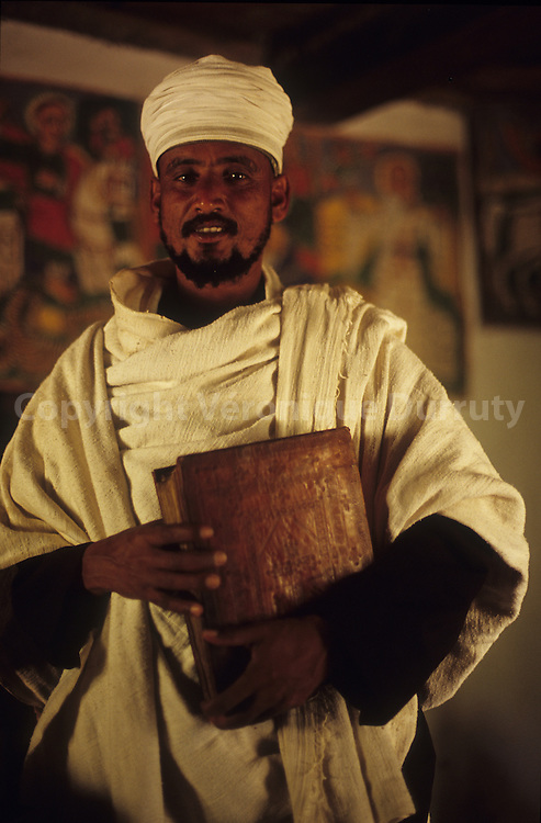 PRIEST OF YEHA MONASTERY WITH AN OLD PRAYERS BOOK, TIGRAY, ETHIOPIA