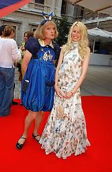 Model CLAUDIA SCHIFFER and artist GRAYSON PERRY (note the fake penis!!!!) at the Royal Academy of Art's SUmmer Party following the official opening of the Summer Exhibition held at the Royal Academy of Art, Burlington House, Piccadilly, London W1 on 7th June 2006.<br />