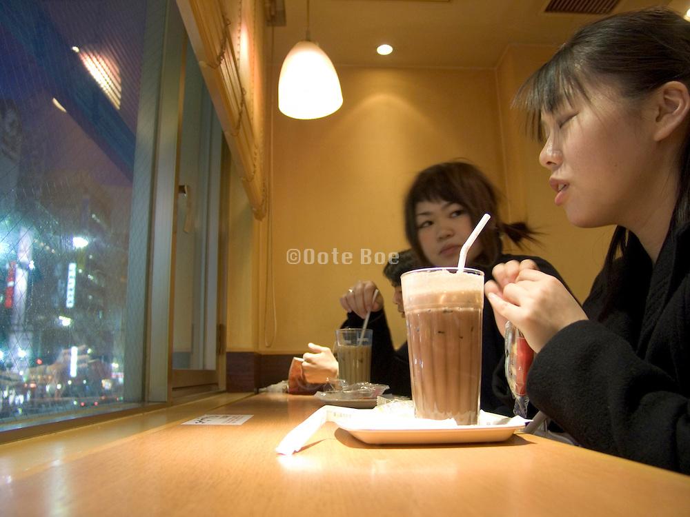 young girls meeting in a coffee bar Okachimachi Tokyo