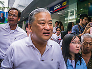 16 JANUARY 2013 - BANGKOK, THAILAND:  SUKHUMBHAND PARIBATRA, candidate for Governor of Bangkok, walks along Silom Road during a campaign appearance in Bangkok. The Oxford educated Sukhumbhand is a member of the Thai royal family (he is a great grandson of the late Thai King Chulalongkorn). He is a member of the Thai Democrat party and was first elected Governor of Bangkok in 2009. He is running for reelection this year. Sukhumbhand faces six challengers in the March 3 election. His toughest opponent is expected to be Police General Pongsapat Pongcharoen, who is running under the banner of the Pheu Thai Party, which controls the Prime Minister's office and Parliament.    PHOTO BY JACK KURTZ