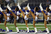 The Dallas Cowboys cheerleaders do a high kick during a dance routine at the NFL week 6 football game against the Washington Redskins on Sunday, Oct. 13, 2013 in Arlington, Texas. The Cowboys won the game 31-16. ©Paul Anthony Spinelli