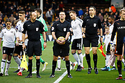 match Referee James Linington and his officials before kick off during the EFL Sky Bet Championship match between Fulham and Barnsley at Craven Cottage, London, England on 23 December 2017. Photo by Andy Walter.