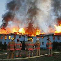 Salem firefighters monitor a abandon building burning at the former Fairview Training Center on Wednesday, Jan. 27, 2010.