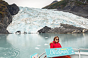 A Philippine tourist poses in front of Coxe Glacier, a tidewater glacier in Barry Arm, Harriman Fjord, Prince William Sound near Whittier, Alaska.