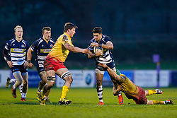 Bristol Rugby Inside Centre Ben Mosses is tackled by Scarlets XV replacement Josh Helps and Flanker Stuart Worrall - Mandatory byline: Rogan Thomson/JMP - 17/01/2016 - RUGBY UNION - Clifton Rugby Club - Bristol, England - Scarlets Premiership Select XV v Bristol Rugby - B&I Cup.