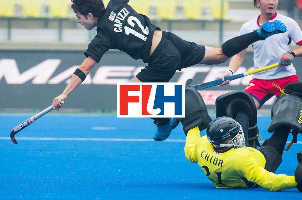 LUCKNOW (India) -   Junior World Cup hockey  U21 for men .  New Zealand v Japan .  Robbie Capizzi (NZL) stopped by goalie Takumi Chida (JPN) COPYRIGHT  KOEN SUYK