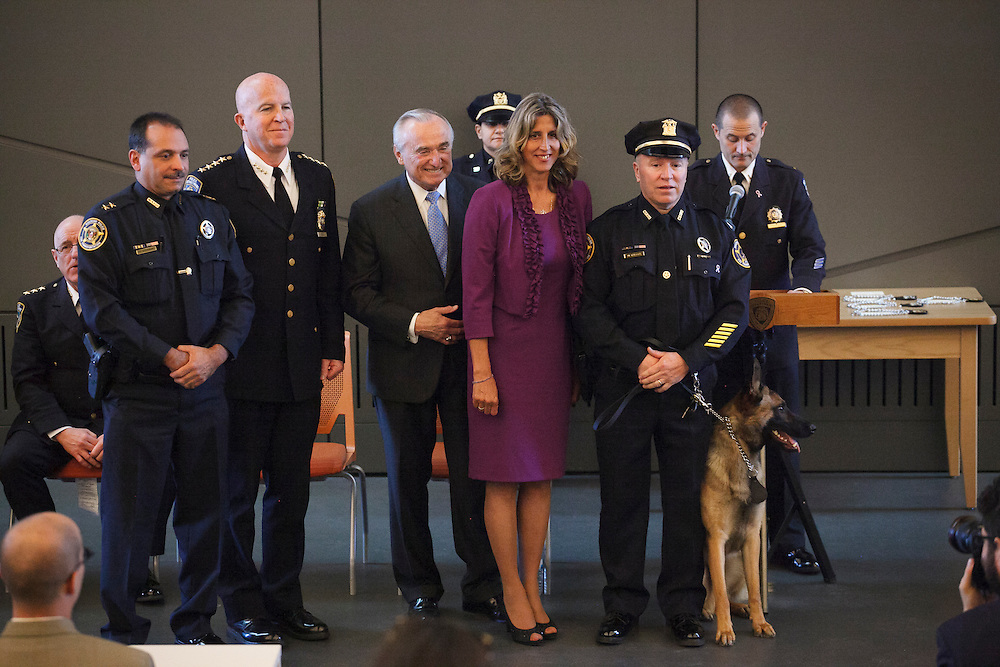 Special Agent Michael O'Keefe of the CSX Police Department with Canine John, honoring Police Officer John D'Allara of ESU Truck 2 who in the September 11, 2001 attacks, with a family member of Mr. D'Allara during the NYPD Transit Bureau Canine Unit Graduation Ceremony at the College Point Police Academy in Queens, NY on Tuesday, Oct. 6, 2015.<br /> <br /> Andrew Hinderaker for The Wall Street Journal<br /> NYSTANDALONE