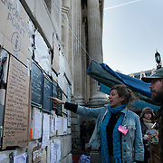 Information Point - onthe corner of St Paul's Cathedral. Day three of the occupation - and the first Monday. The Occupy London Stock Exchange movement was formed in London in solidarity with the US based Occupy Wall Street. The movements are a respons and in anger to what is seen by many as corporate greed and a failed banking system being bailed out by the public, - which in return are suffering austerity measures to make up for the billions of lost money. The movement occupied the St Paul's Square in the City of London Sat Oct 15 after it failed to secure and occupy Pator Noster Square and the Stock Exchnage itself.