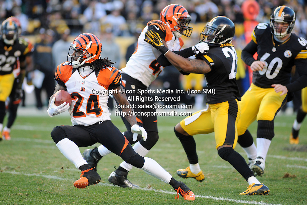 Dec. 23, 2012 - Pittsburgh, PENNSYLVANNIA, U.S - December 23rd, 2012 - Cincinnati Bengals cornerback Adam Jones (24) changes direction to try an avoid Pittsburgh Steelers free safety Ryan Mundy (29) and Pittsburgh Steelers long snapper Greg Warren (60) on the punt return for a short gain of 2 yards in the fourth quarter as the Pittsburgh Steelers take on the Cincinnati Bengals at Heinz Field in Pittsburgh, PA.