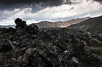 Highlands of Iceland, Fjallabak area. Laugahraun lavafield. Mountain Norðurbarmur in background. Að fjallabaki. Þungskýjað yfir Laugahrauni. Norðurbarmur í baksýn.