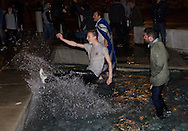 Pro-independence supporters splashing water in one of the fountains outside the Scottish parliament building in Edinburgh as the results of the referendum on Scottish independence are announced. The Yes Scotland movement campaigned for a vote which would have forced Scotland to leave the United Kingdom. On the 18th of September 2014, the people of Scotland voted in a referendum that the country's union with England should continue and Scotland should not become an independent nation once again.