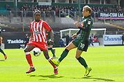 Oscar Threlkeld (18) of Plymouth Argyle on the attack covererd by Omar Beckles (5) of Accrington Stanley during the EFL Sky Bet League 2 match between Plymouth Argyle and Accrington Stanley at Home Park, Plymouth, England on 1 April 2017. Photo by Graham Hunt.